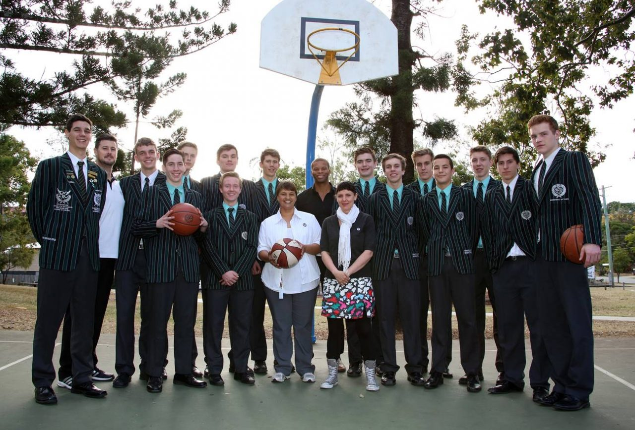 Brisbane Boys College' basketball team with Maria and Joanne from Micah Projects